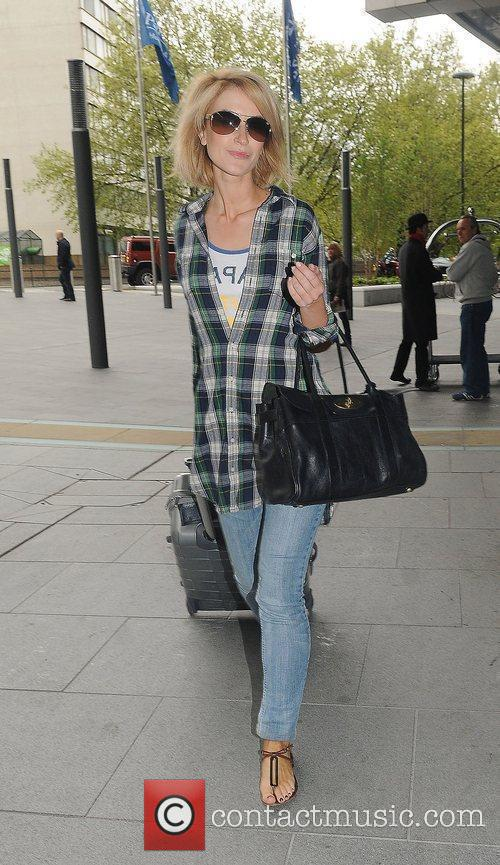 Leaving her hotel after attending the 2010 British...