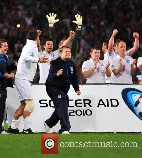 James Corden and the England team celebrate a...