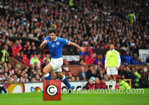 Louis Figo on the ball 2010 Unicef Soccer...