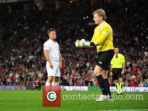 Robbie Williams and Patrick Kielty 2010 Unicef Soccer...