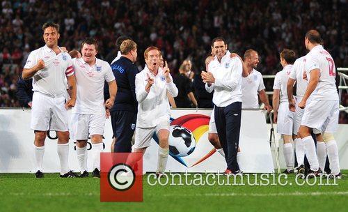 The England team celebrate a goal 2010 Unicef...