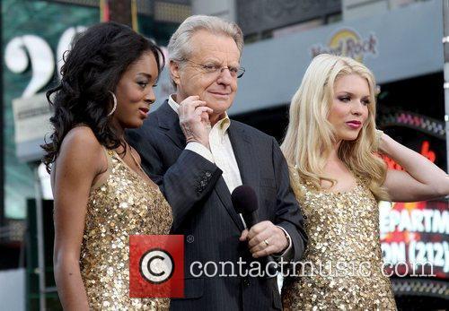 TV Host Jerry Springer with models Joslynne Hood...