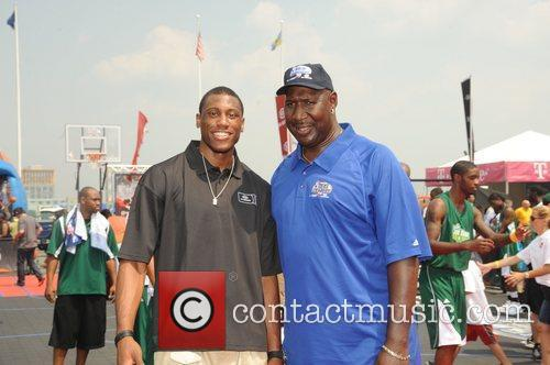 NBA star Thad Young and Darryl Dawkins at...