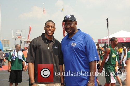 NBA star Thad Young and Darryl Dawkins at...