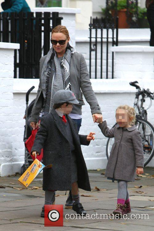 Pregnant Stella McCartney dropping her children off at...