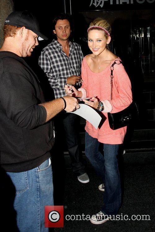 Stephanie Pratt signing an autograph while leaving Katsuya...