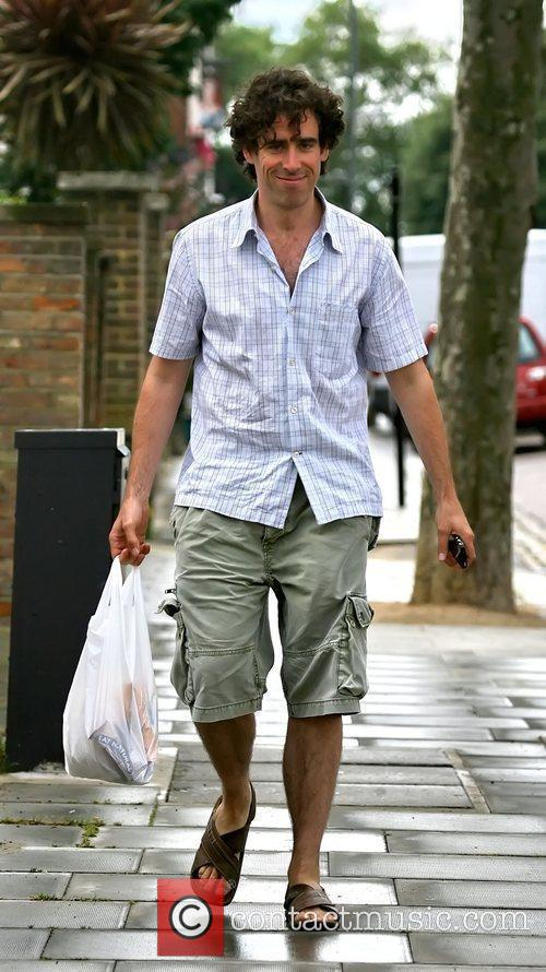 Walking with a shopping bag in North London