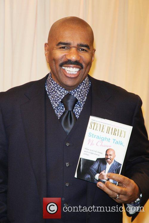 Signs copies of his new book 'Straight Talk,...