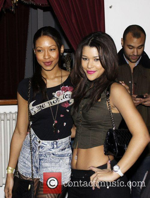 Shanika Warren-Markland (L) and guest attending the wrap...