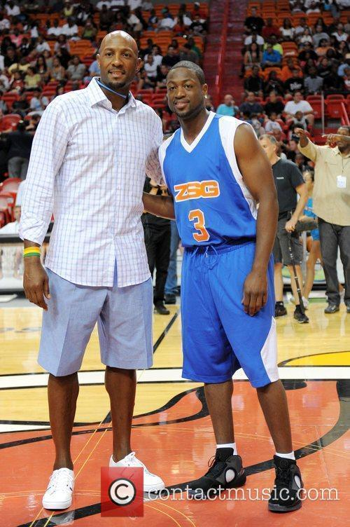 Alonzo Mourning and Dwayne Wade appear at the...