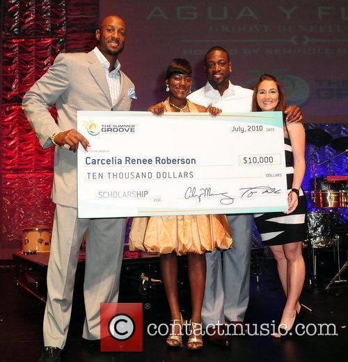 Alonzo Mourning and winner of Publix achievement award,...