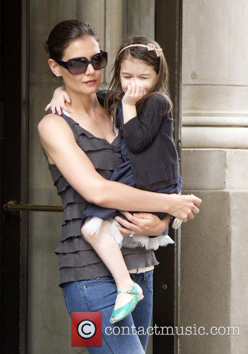 With her daughter Suri leaving their apartment building
