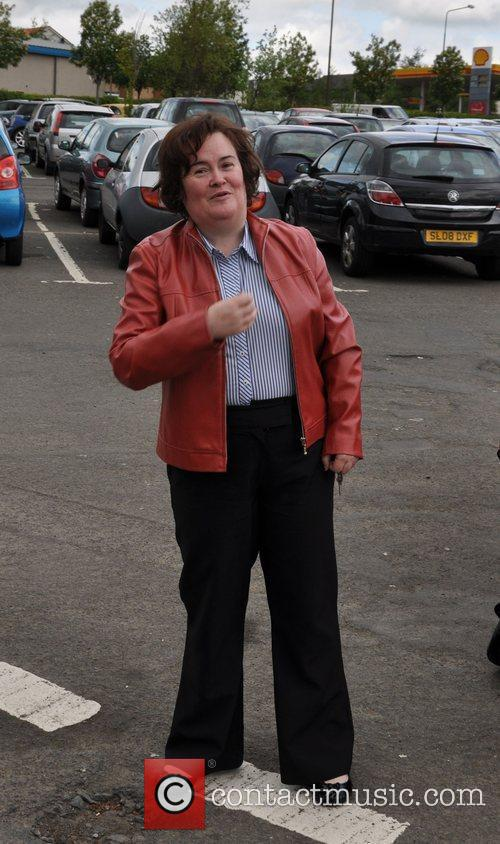 Susan Boyle sporting a red leather jacket as...