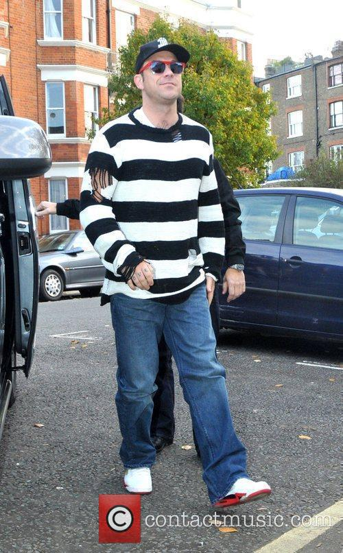 Robbie Williams of Take That arriving at Maida...