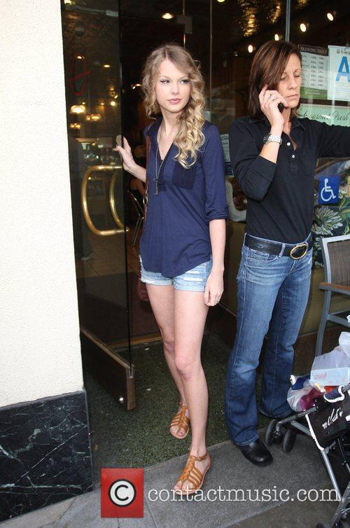 Taylor Swift, friends leaving The Farm restaurant in Beverly Hills, stop by Coffee Bean and Tea Leaf next door to pick up coffee. 16