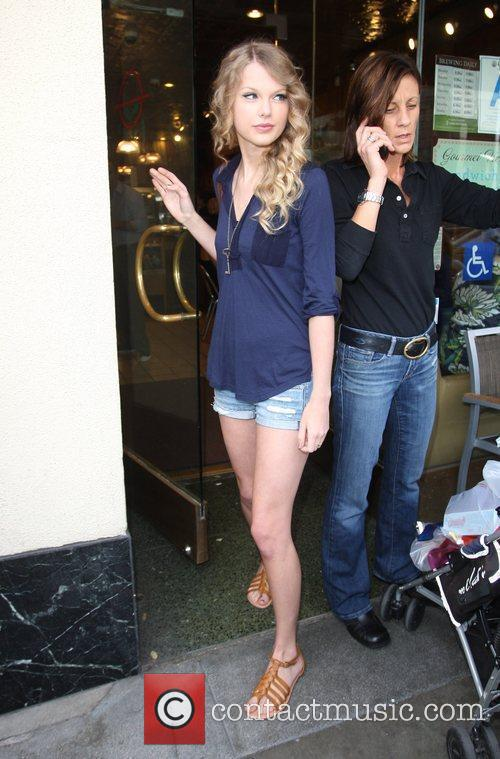Taylor Swift, friends leaving The Farm restaurant in Beverly Hills, stop by Coffee Bean and Tea Leaf next door to pick up coffee. 17