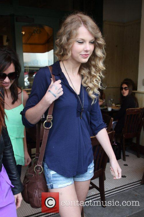 Taylor Swift, friends leaving The Farm restaurant in Beverly Hills, stop by Coffee Bean and Tea Leaf next door to pick up coffee. 24