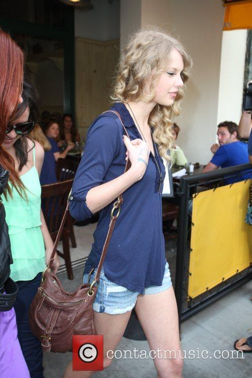 Taylor Swift, friends leaving The Farm restaurant in Beverly Hills, stop by Coffee Bean and Tea Leaf next door to pick up coffee. 27