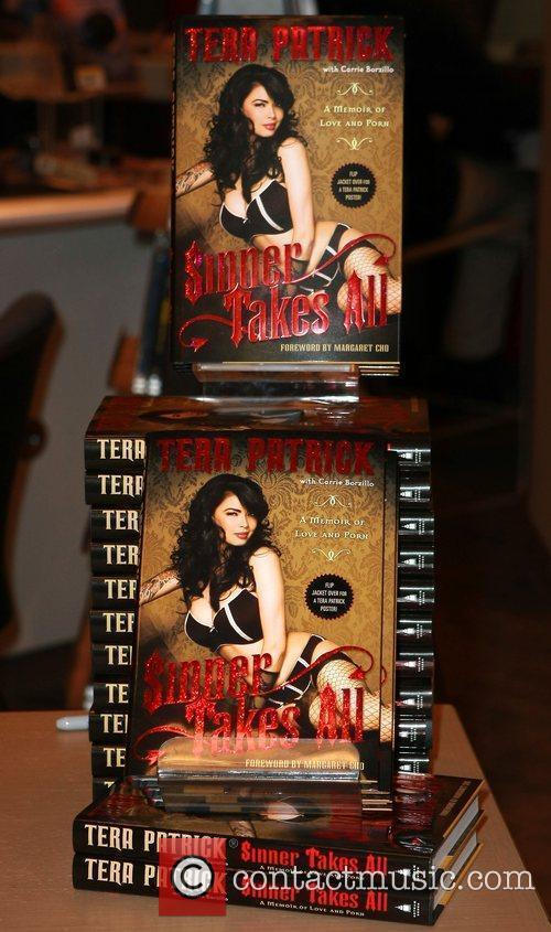 Atmosphere Tera Patrick signs copies of her book...