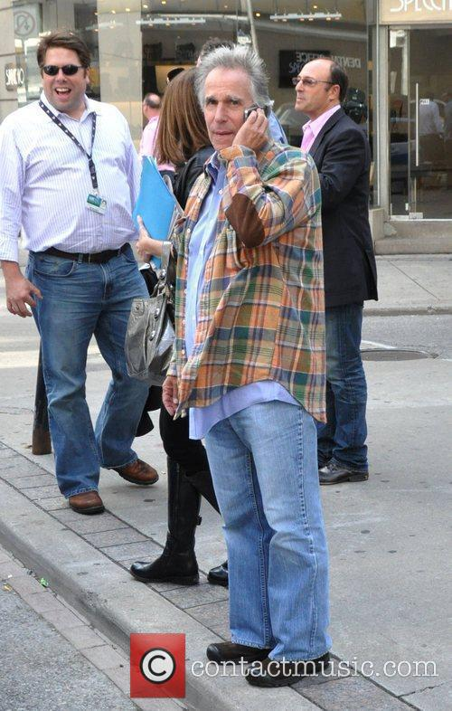 Henry Winkler out and about talking on his...