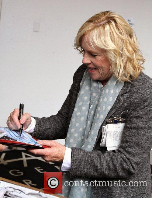 Amy Madigan greets and signs autographs for fans...