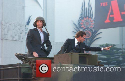 Sharlto Copley and Bradley Cooper 3