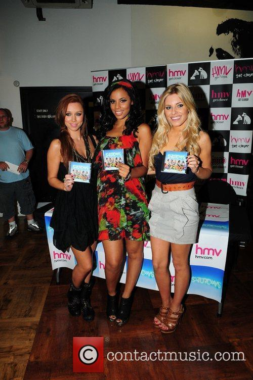Promoting and signing copies of their album 'Headlines'...