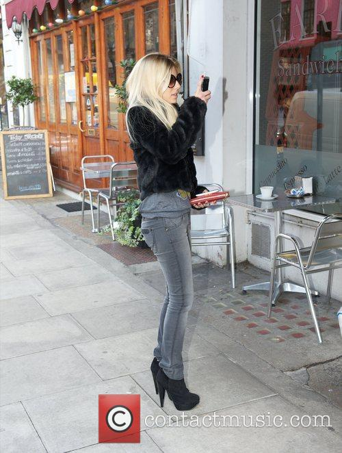 Mollie King of The Saturdays, using her phone...