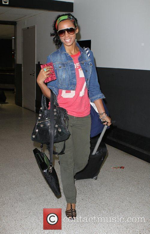 The Saturdays arrive at LAX airport