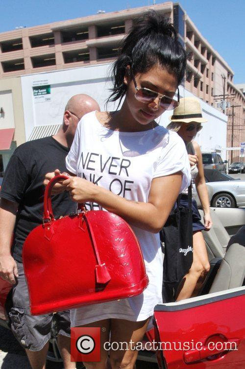 Vanessa White The Saturdays are seen shopping at...