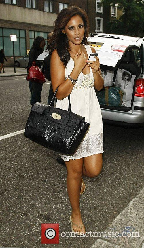 The Saturdays leave a London studio after having...