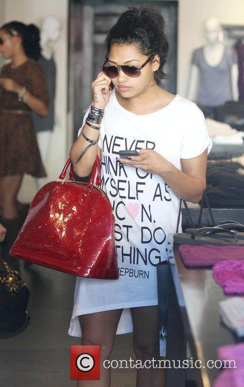 Vanessa White The Saturdays are seen shopping on...