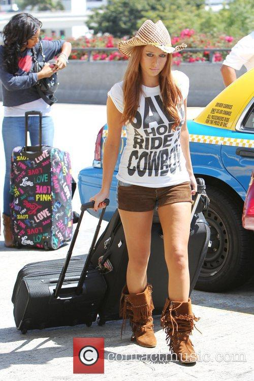 The Saturdays are seen arriving at LAX airport...