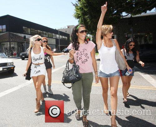 The Saturdays are seen shopping at various boutiques...