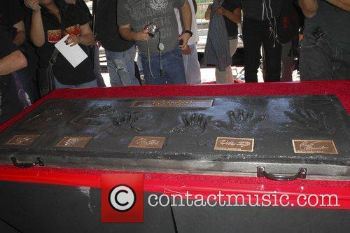 Hand prints The Scorpions are inducted on Hollywood's...