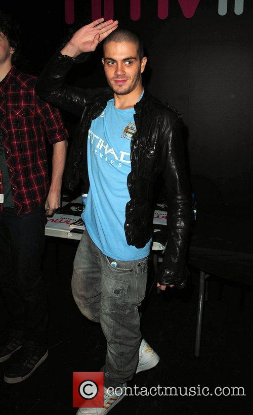 Max George The Wanted sign copies of their...