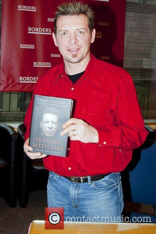 Theo Fleury signs copies of his new book...