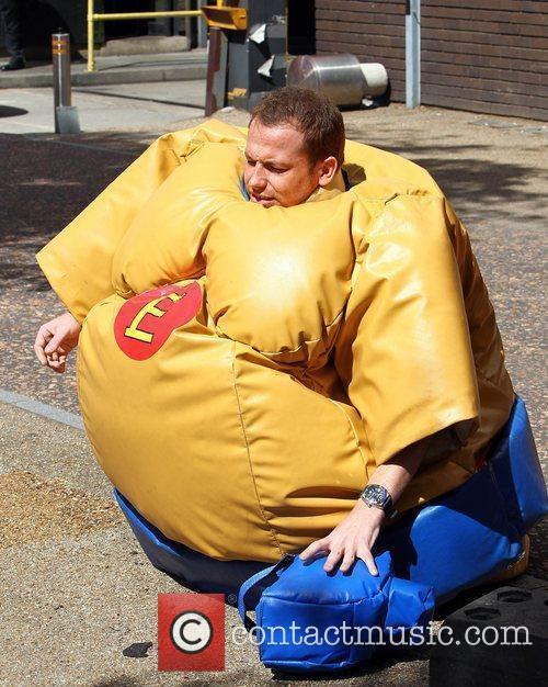 Joe Swash in a sumo suit outside the...