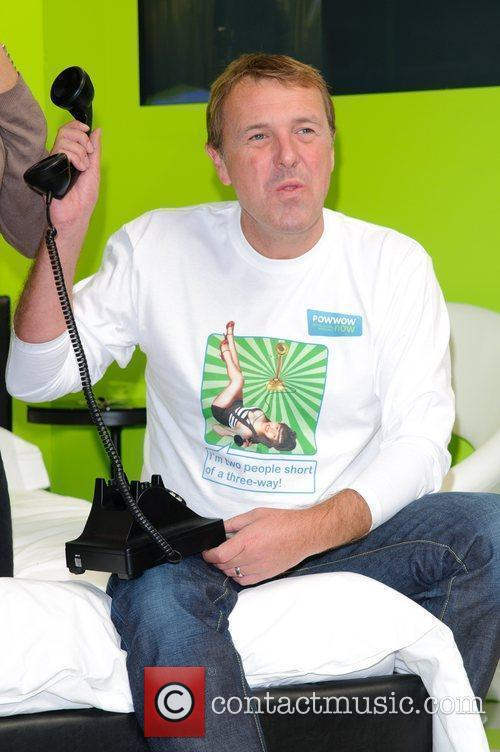 Phil Tufnell poses in a giant bed before...