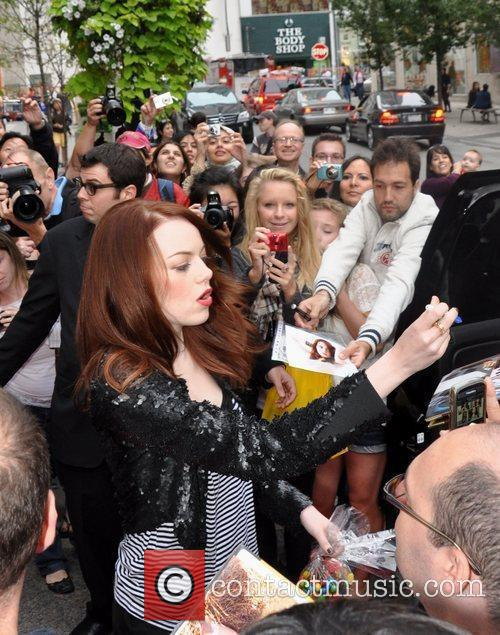 Emma Stone signing autographs for fans while promoting...