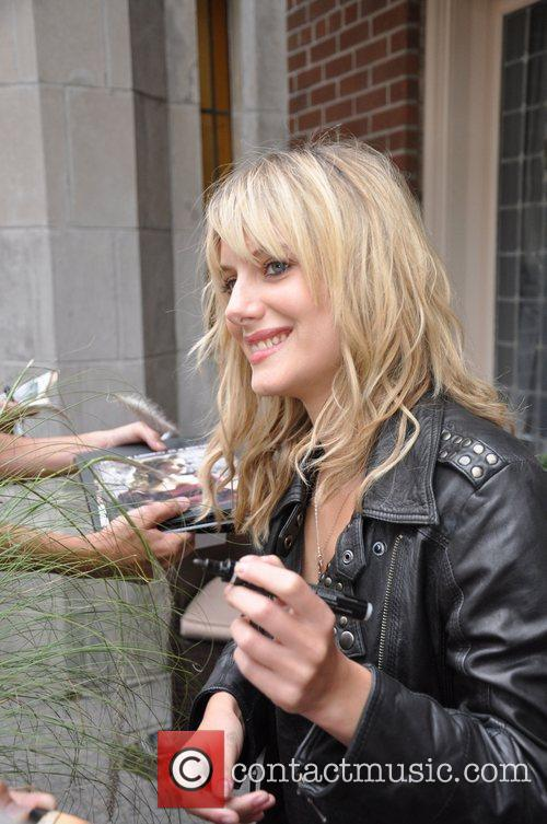Melanie Laurent signing autographs outside her hotel during...