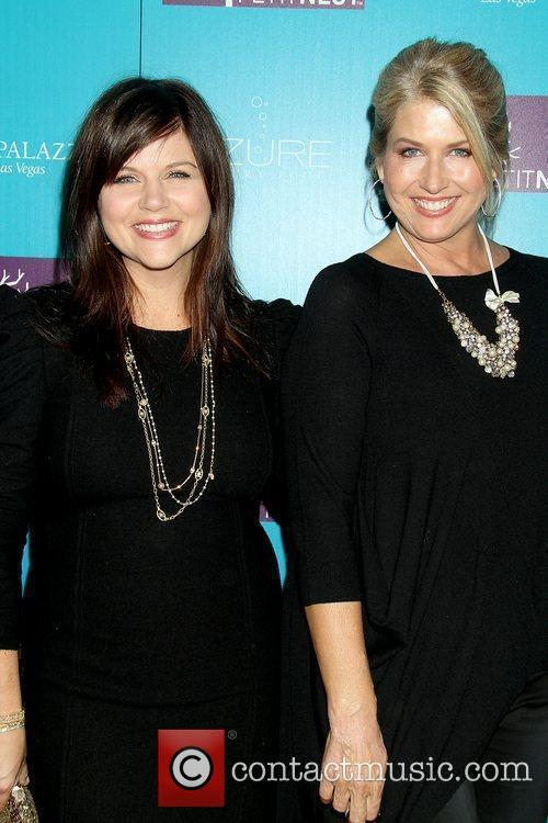 Tiffani Thiessen and Lonni Paul celebrate the launch...