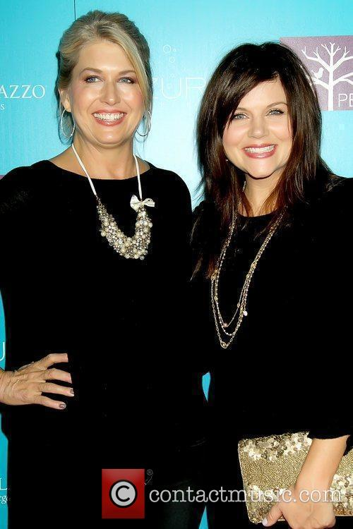 Lonni Paul and Tiffani Thiessen celebrate the launch...