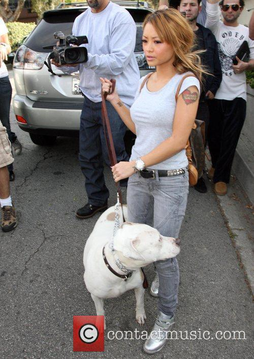 Tila Tequlia  leaves her house in the...
