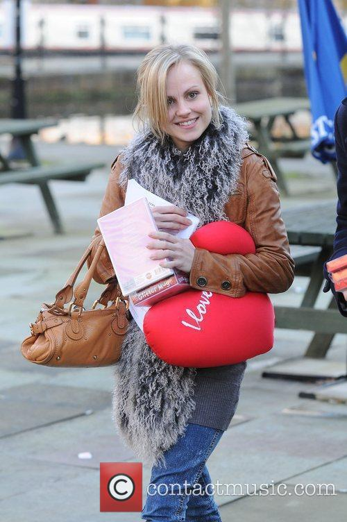 Tina O'Brien carrying presents given to her by...