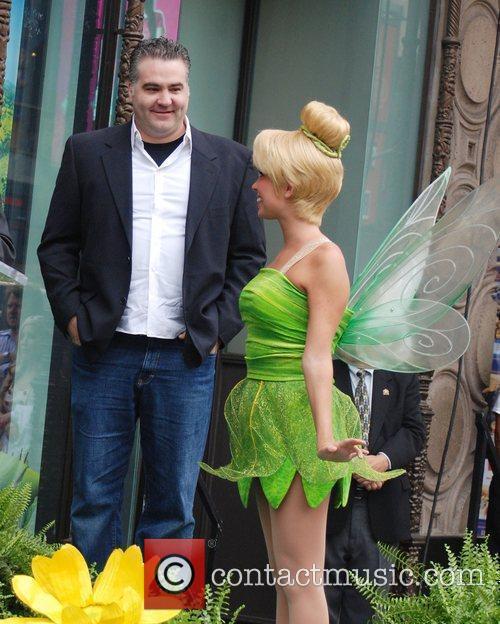 Bradley Raymond and Tinker Bell Tinker Bell receives...