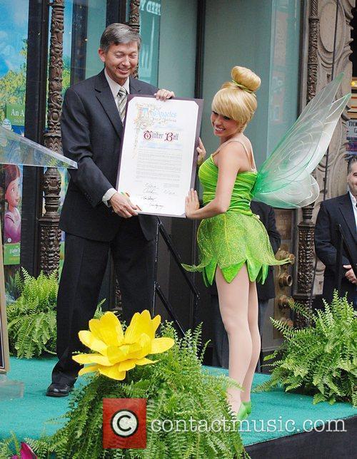 Leron Gubler and Tinker Bell Tinker Bell receives...