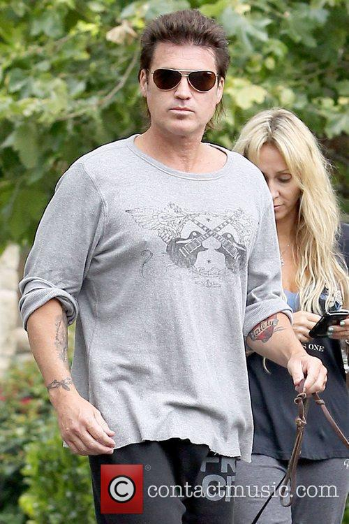 Billy Ray Cyrus walking his dogs with his...