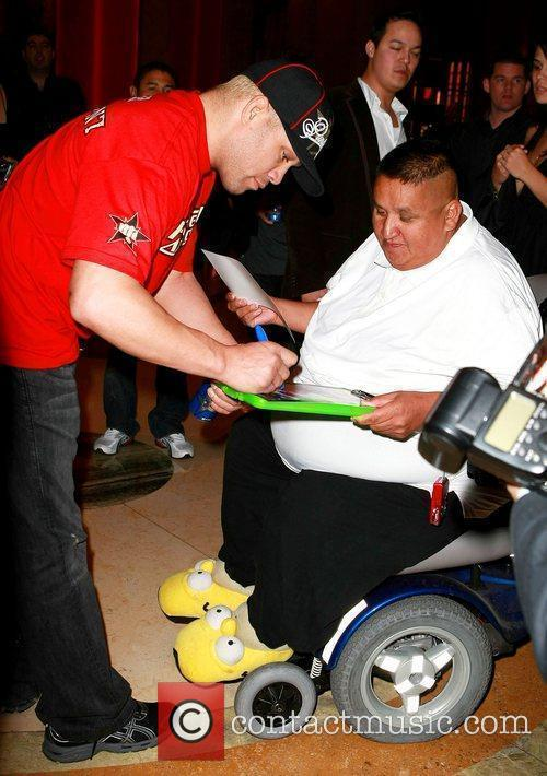 Tito Ortiz signs an autograph for fan Bryan...