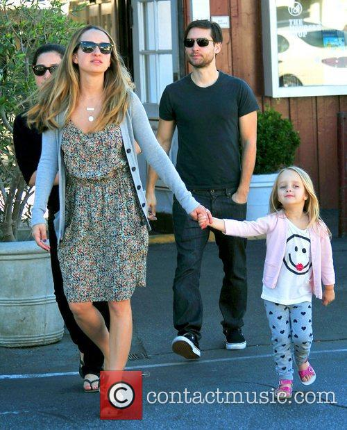 Tobey Maguire and his wife Jennifer Meyer (front)...
